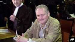 Venezuelan international terrorist Carlos the Jackal, foreground, whose real name is Ilich Ramirez Sanchez, sits in a Paris courtroom. (File)