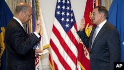 Leon Panetta is sworn is as Defense Secretary Pentagon General Counsel Jeh Johnson, at the Pentagon, July 1, 2011