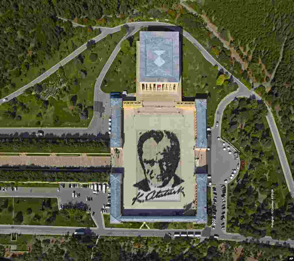 In this aerial photo made available by the Turkish Military, some 6,000 people form a large portrait of Mustafa Kemal Ataturk, the founder of modern Turkey at his mausoleum in Ankara.