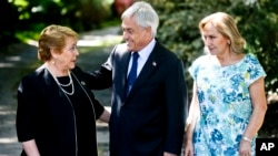 Chilean President Michelle Bachelet, left, talks with president-elect Sebastian Pinera, a former president, as Pinera's wife Cecilia Morel stands by in Santiago, Chile, Dec. 18, 2017.