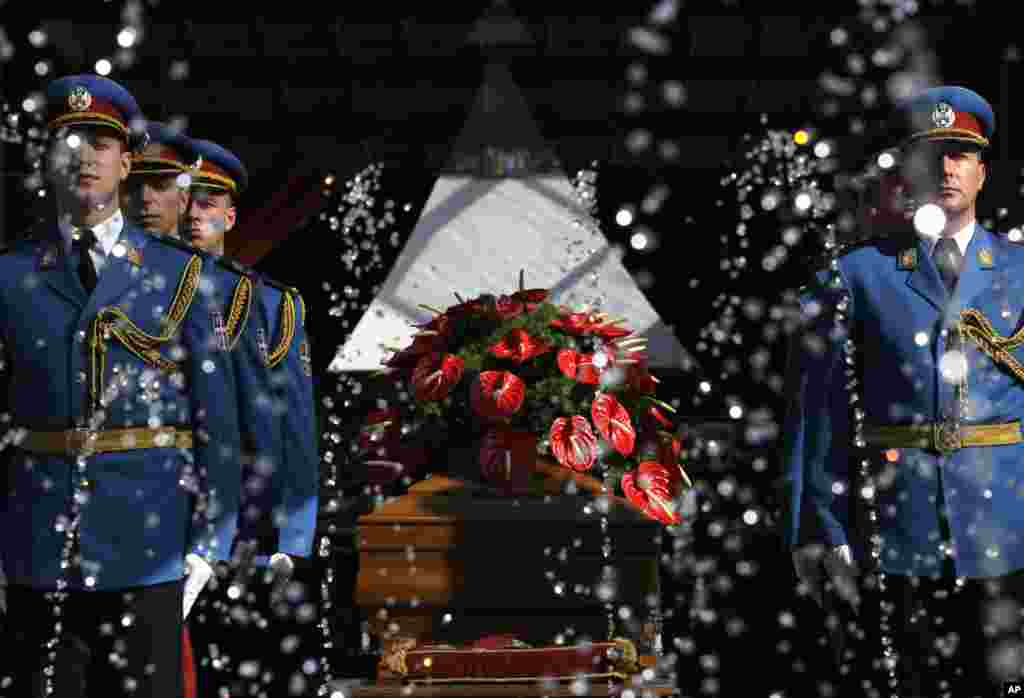 The casket bearing the body of Jovanka Broz, widow of the former Yugoslav communist leader Josip Broz Tito, sits in front of the House of Flowers memorial complex before the funeral in Belgrade, Serbia. Former first lady was laid to rest near the grave of her husband.