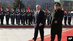 U.S. Secretary of Defense Robert Gates, left, participates in an arrival ceremony with China's Minister of National Defense Gen. Liang Guanglie, right, at Bayi Building in Beijing, China, on Monday January 10, 2011