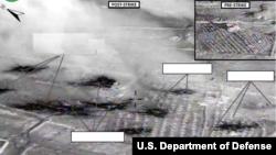 ការទម្លាក់គ្រាប់បែករបស់កងកម្លាំងចម្រុះទៅលើគេហដ្ឋានរបស់ Abu Kamal នៃក្រុម ISIL នៅ Raqqah ប្រទេសស៊ីរីកាលពីថ្ងៃទី២៣ ខែកញ្ញា ឆ្នាំ២០១៤។ (U.S. Central Command Center)