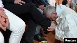Pope Francis washes the feet of some inmates at the Paliano prison, south of Rome, April 13, 2017. Osservatore Romano/Handout via Reuters.