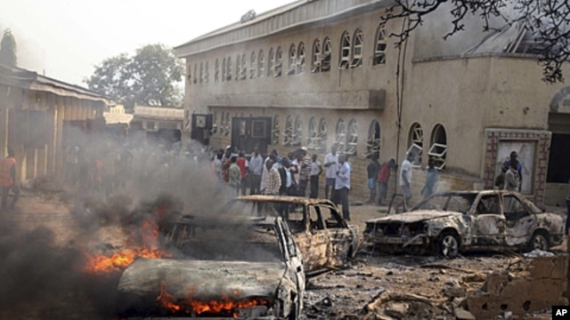 A car burns at the scene of a bomb explosion at St. Theresa Catholic Church at Madalla, Suleja, just outside Nigeria's capital Abuja. Five bombs exploded on Christmas Day at churches in Nigeria, one killing at least 27 people, raising fears that Islamist