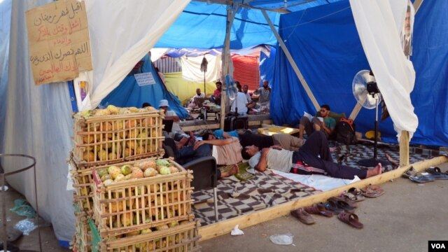 Some people are operating businesses like prickly-pears for sale in crates, but pro-Morsi protesters say most of the people living in this tent village spend the hot days resting, reading Koran, and preparing for rallies. (Heather Murdock for VOA)