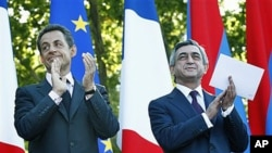 French President Nicolas Sarkozy, left, and Armenian President Serge Sarkisian in Yerevan, Armenia, October 7, 2011.