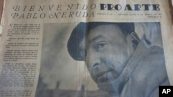 FILE - A copy of an old newspaper featuring Chile's Nobel-Prize winning poet Pablo Neruda is seen in his home in Santiago, Chile, Nov. 8, 2013.