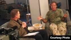 Then-American Forces Network reporter Kane Farabaugh interviews Robin Williams in Afghanistan in 2002.