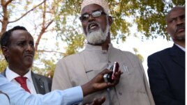 Ahmed Madobe, leader of the Ras Kamboni militia, speaks during a meeting for the creation of a State of Jubaland in Kismayo, Somalia, Feb. 28, 2013.