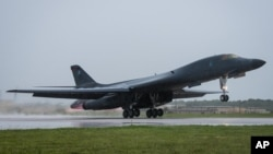 In this photo released by the U.S. Air Force, a B-1B Lancer bomber assigned to 37th Expeditionary Bomb Squadron, deployed from Ellsworth Air Force Base, South Dakota, takes off from Andersen Air Force Base, Guam, Sept. 9, 2017.