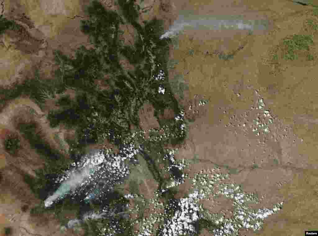 Smoke plumes from wildfires in Colorado are pictured in this satellite image.