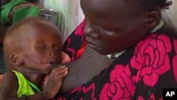In this photo taken from Video provided by Associated Press on Tuesday, May 13, 2014, a malnourished child is fed by her mother in a Medecins Sans Frontiers (Doctors Without Borders) hospital, in Leer, South Sudan.