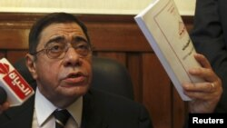 Egypt's General Prosecutor Abdel Maguid Mahmoud speaks to reporters in his office in the High Court in Cairo, October 13, 2012.
