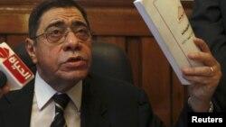 အီဂ်စ္ ေရွ႕ေနခ်ဳပ္ Abdel Maguid Mahmoud ကိုင္႐ိုၿမိဳ႕ ႐ံုးခန္းမွာ သတင္းေထာက္မ်ားနဲ႔ ေတြ႔ဆံုစဥ္။ (ေအာက္တိုဘာလ ၁၃ ရက္၊ ၂၀၁၂)။