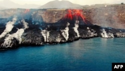 This image grab taken from a video provided by the Spanish Institute of Oceanography shows an aerial shot from the oceanographic vessel Ramon Margalef (IEO) of the delta formed on the coast from the lava of the Cumbre Vieja volcano, on the Canary Island of La Palma on October 4,