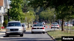 FILE - Police vehicles are seen on an Ohio street