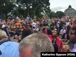 About 100 protesters waited outside the Capitol, in Washington, June 23, 2016. After ending their sit-in on the House floor, House Democrats exited the Capitol to thank supporters who had gathered.