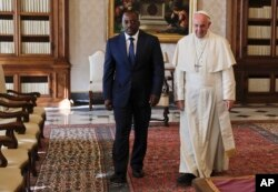 FILE - Pope Francis meets Congo President Joseph Kabila during a private audience in the pontiff's studio, at the Vatican, Sept. 26, 2016.