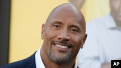 "FILE - Actor Dwayne Johnson attends the premiere of his film ""Central Intelligence"" in Los Angeles, June 10, 2016. Johnson's income has swelled from upfront fees for ""Central Intelligence"" and ""Fast 8,"" as well as the forthcoming ""Baywatch,"" Forbes magazine said."