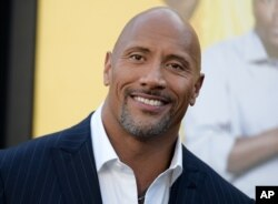 """FILE - Actor Dwayne Johnson attends the premiere of his film """"Central Intelligence"""" in Los Angeles, June 10, 2016."""