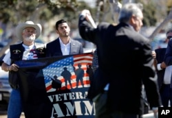 Latino, Arab-American businessman Ammar Campa-Najjar (center) ran for Congress in Southern California's 50th district, pictured Oct. 16, 2018, in San Diego.