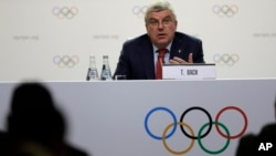 International Olympic Committee President Thomas Bach speaks at press conference in Buenos Aires, Argentina, Oct. 4, 2018. He said then that Calgary, Stockholm and a pair of Italian cities would be proposed as official candidates for approval to host the 2026 Winter Games. A committee in Calgary is now recommending that the city drop out.