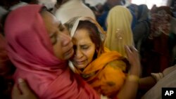 Pakistani Christian women mourn the deaths of their family members during a funeral service at a local church in Lahore, Pakistan, March 28, 2016.