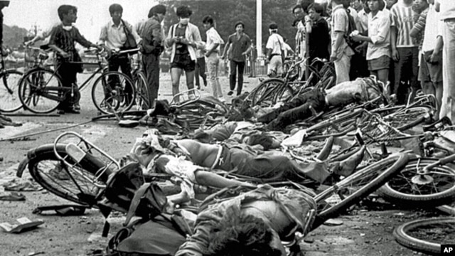 FILE - The bodies of dead civilians lie among mangled bicycles near Beijing's Tiananmen Square, June 4, 1989.