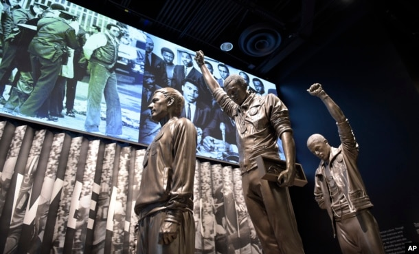 FILE - A statue of the 1968 Olympics Black Power salute is on display at the National Museum of African American History and Culture in Washington, Sept. 14, 2016.