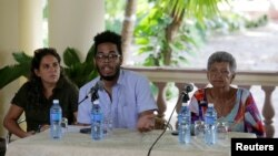 (L-R) Yaniska Lugo, of the Martin Luther King Center, Manolo de los Santos, board member of the Pastors for peace and Nacyra Gomez, of the Presbyterian Cuban Church attend a news conference in Havana, Cuba, Sept. 7, 2016.