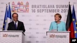Francuski predsednik Fransoa Oland i nemačka kancelarka Angela Merkel na samitu EU u Bratislavi