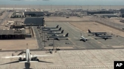 Qatari planes wait at Hamad International Airport (HIA) in Doha, Qatar. Qatar's foreign minister says Kuwait is trying to mediate a diplomatic crisis in which Arab countries have cut diplomatic ties.