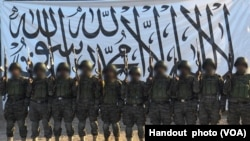 FILE - In Afghanistan, the Taliban released to the media this picture, which it said shows the suicide bombers who attacked the army base in Mazar-i-Sharif, April 21, 2017.