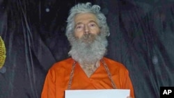 Undated handout photo shows retired FBI agent Robert Levinson. His family received these photographs in April 2011.