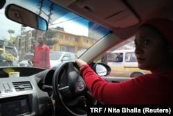 Faridah Khamis, 36, single mother of five children drives her cab through the streets of Nairobi, Kenya, April 19, 2018.