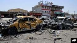Hiện trường vụ đánh bom tự sát ở Tuz Khormato ở Iraq, ngày 9/6/2014.