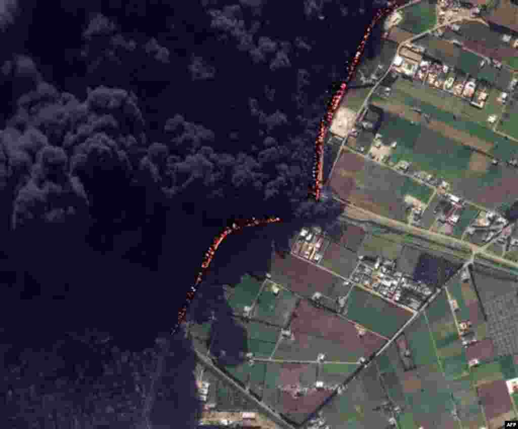 This Wednesday Feb. 15, 2012 satellite image shows a pipeline fire in Homs, Syria. The pipeline, which runs through the rebel-held neighborhood of Baba Amr, in Homs, had been shelled by regime troops for the previous 12 days, according to two activist gro