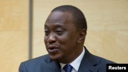 """FILE - President Uhuru Kenyatta urged Kenyans """"to not allow those who hide and abet the terrorists to compromise and even destroy the development that is fast growing in your area."""""""