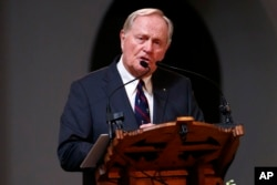 Golfer Jack Nicklaus makes remarks during a memorial service for golfer Arnold Palmer in the Basilica at St. Vincent's College in Latrobe, Pennsylvania, Oct. 4, 2016.