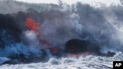 Lava flows into the ocean near Pahoa, Hawaii, May 20, 2018.