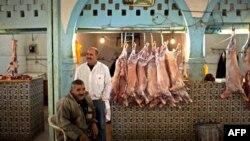 Butchers wait for customers in a market in Ben Guerdane, near the Tunisia-Libyan border, Tunisia, (File)