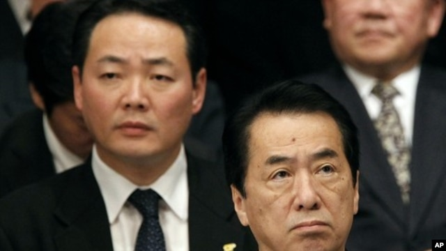 Japan's Prime Minister Kan attends a rally to call on Russia to return a group of islands, in Tokyo, February 7, 2011