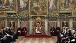 Pope Benedict XVI delivers his speech during an audience with foreign ambassadors to the Holy See, at the Vatican, January 7, 2013.