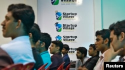 FILE - Entrepreneurs, employees and students listen to a speech during the Start-up saturday event at the Start-up Village in Kinfra High Tech Park in the southern Indian city of Kochi, Oct. 13, 2012.