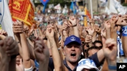 Supporters of leader of The League party Matteo Salvini chant slogans at the party's rally in Pontida, northern Italy, Sept. 15, 2019.