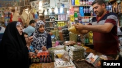 People shop for the Muslim fasting month of Ramadan at the Shorja wholesale market in central Baghdad, Iraq, June 6, 2016.