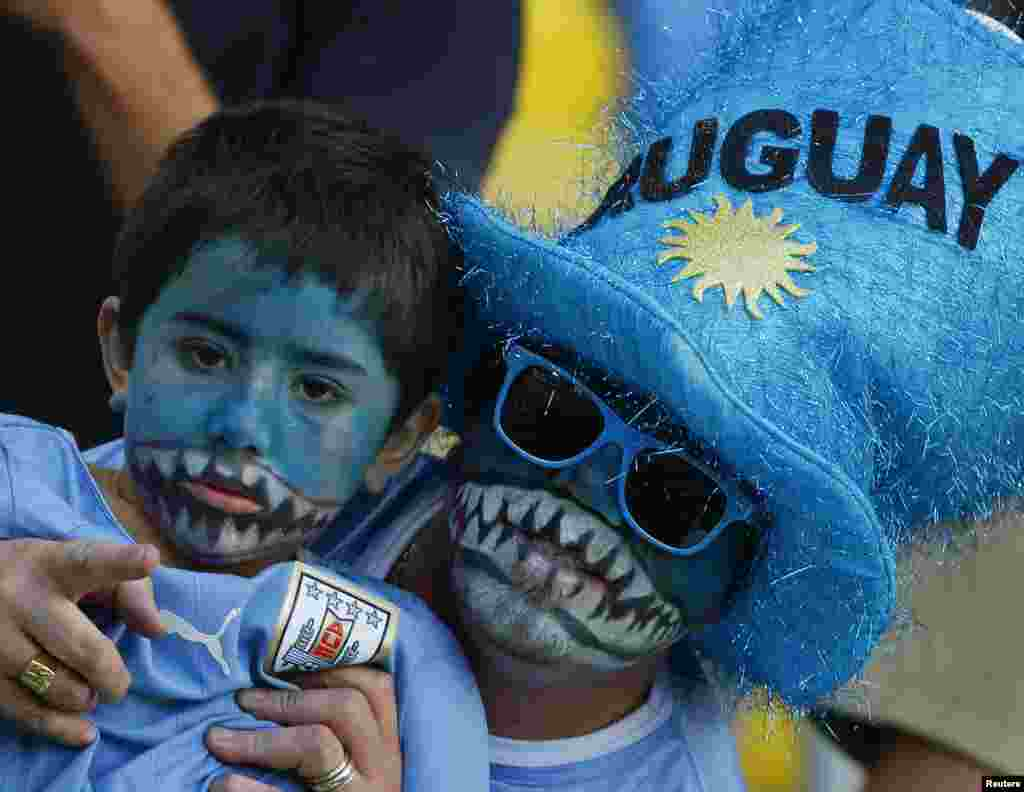 Uruguay fans bare their teeth before the game against Colombia at the Maracana stadium in Rio de Janeiro, June 28, 2014.