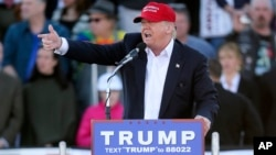 FILE - Republican presidential candidate Donald Trump points as he speaks during a rally Feb. 28, 2016.