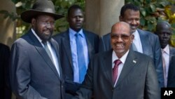 South Sudan's President Salva Kiir, left, meets with Sudan's President Omar al-Bashir, right, in the capital Juba, South Sudan, Jan. 6, 2014.